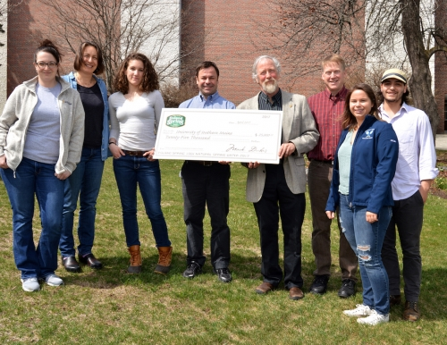 Environmental Science faculty and students receive check from Poland Spring rep