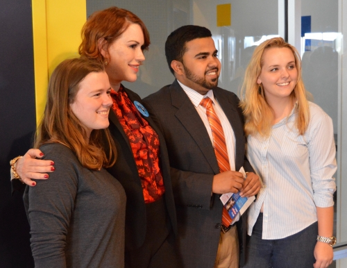Molly Ringwald posing for a photo with USM students