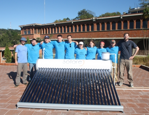 Photo of eight students and two professional engineering mentors from the USM chapter of Engineers Without Borders. The group spent a week in Villa Nueva, Guatemala, where they installed five solar water heaters for the Hogar Rafael Ayau orphanage.