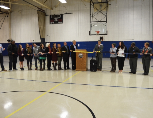 Photo of the ribbon cutting of the Recovery Oriented Campus Center, The ROCC, at USM