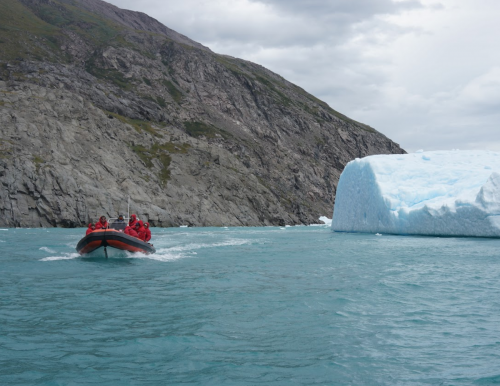 Researchers in front of glacier