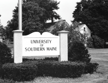 black and white photo of university welcome sign