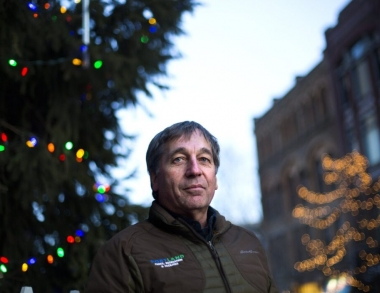 City Arborist Jeff Tarling stands before this year's holiday tree at Monument Square. Staff photo by Derek Davis