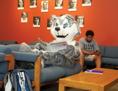 Champ reading the lastest Parking Services update