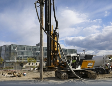 A photo of a pile driver at work on the USM campus