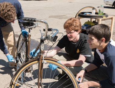 volunteers work on bikes