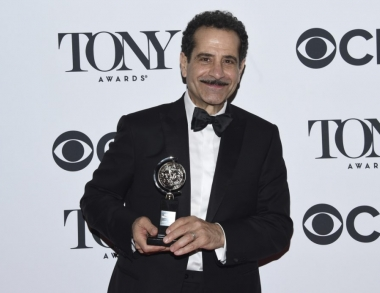 Tony Shalhoub poses with Tony Award/AP Photo
