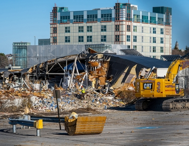 A photo of the demolition of Woodbury Campus Center