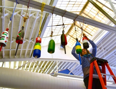 Artist Natasha Mayers hanging buoys