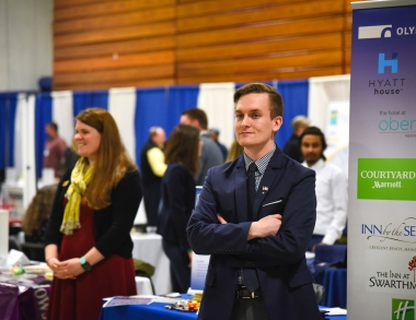 employer representative awaiting students at 2018 job fair