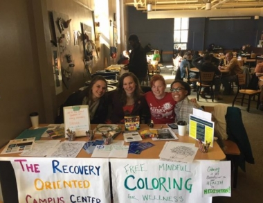 Group of students at a table to promote a NAMI club on campus