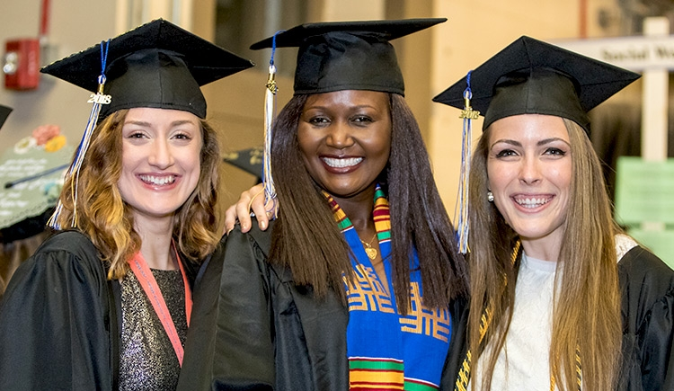 Florence Auma Aliardo '18 and two of her classmates at Commencement