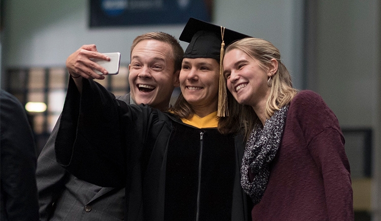 Graduate taking selfie