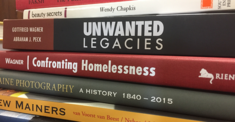 A stack of books by USM faculty authors
