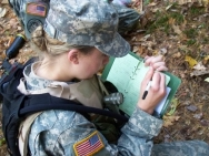 ROTC cadet taking notes