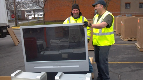 USM EWaste Recycling Day - Giant TV being moved by NorthCoast Recycling
