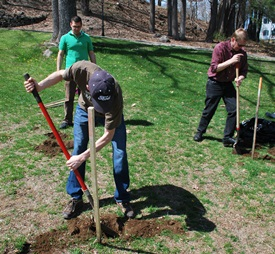 Members of the USM Environmental Science Dept, Sustainabilty Office, and Grounds Crew plant sapling during Earth Week 2011
