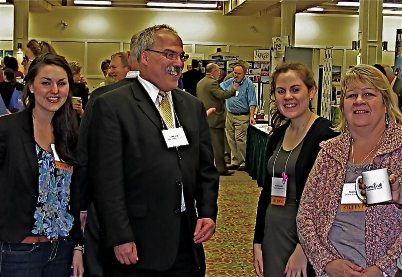 Deans List students (l-r) Casey Lovejoy, Jenna Rossnagel and Marjorie Jarry at the Governor's Conference on Tourism with TAH Advisory Board member Greg Dugal of the Maine Innkeepers Association.