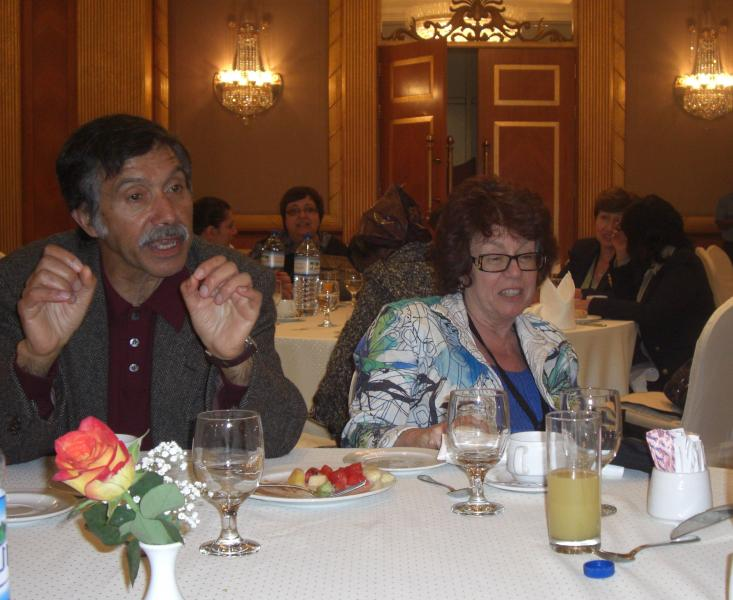 Susan Feiner and conference participants at dinner