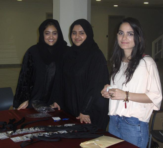 UAE students assisting at registration